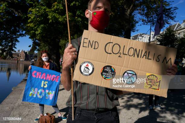 Demonstrators carry placards referring to climate change during the demonstration in The Hague on September 1 2020 in The Hague Netherlands...