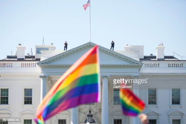 Demonstrators carry rainbow flags past the White House during the Equality March for Unity and Peace on June 11 2017 in Washington DC Thousands...