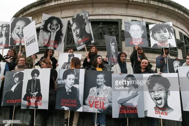 Demonstrators carry signs and banners on the place de la République in Paris on March 8 2018 during the International Woman's Day on March 8 2018