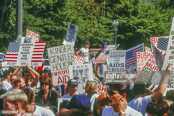demonstrators carry signs and march in front of the White House Washington DC September 30 1991 Among the visible signs are ones that read 'George...
