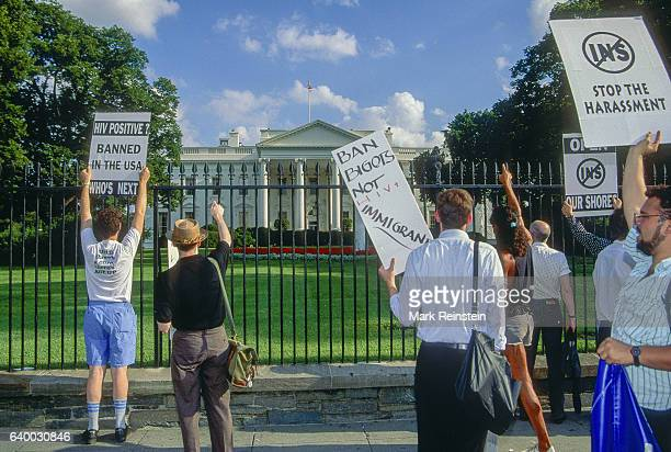 demonstrators carry signs and march in front of the White House Washington DC September 30 1991 Among the visible signs are ones that read 'HIV...