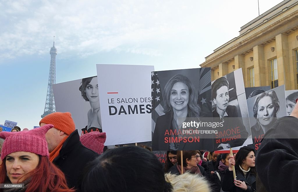 Demonstrators carry signs featuring women during a rally in solidarity with supporters of the Women's March in Washington and many other cities on January 21, 2017 at the Place de Trocadero in Paris, one day after the inauguration of the US President Donald Trump. Protest rallies were held in over 30 countries around the world in solidarity with the Washington Women's March in defense of press freedom, women's and human rights following the official inauguration of Donald J Trump as the 45th President of the United States of America. / AFP / Eric FEFERBERG