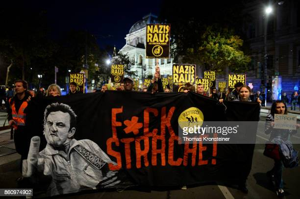 Demonstrators carry signs reading 'Nazis get out' and 'Fuck Strache' during a protest on October 13 2017 in Vienna Austria Austria will hold...