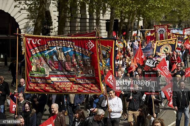 Demonstrators carry Trade Union baners as they march in central London on May 1 during the annual May Day rally Hundreds rallied peacefully in...