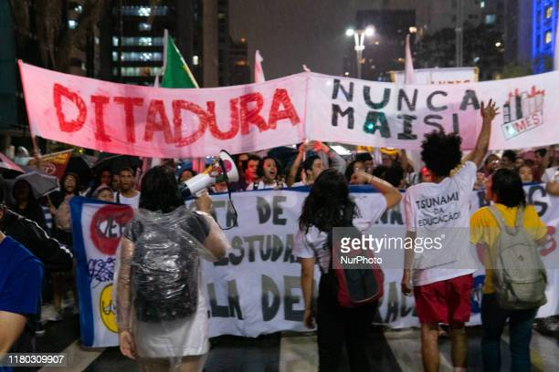 """Demonstrators carrying a sign that reads """"Dictatorship neve again"""" during protest against the current Brazilian President Jair Messias..."""