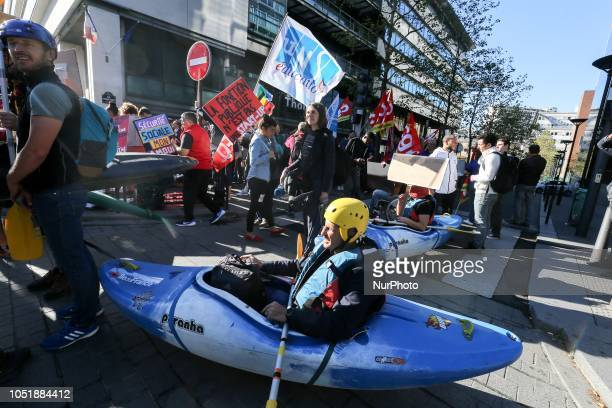 Demonstrators carrying canoe gather in front of the offices of the French Ministry of Sports in Paris on October 11 2018 against the plans for...