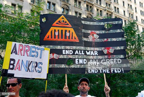 Demonstrators carrying signs at Occupy Wall Street movement in NYC