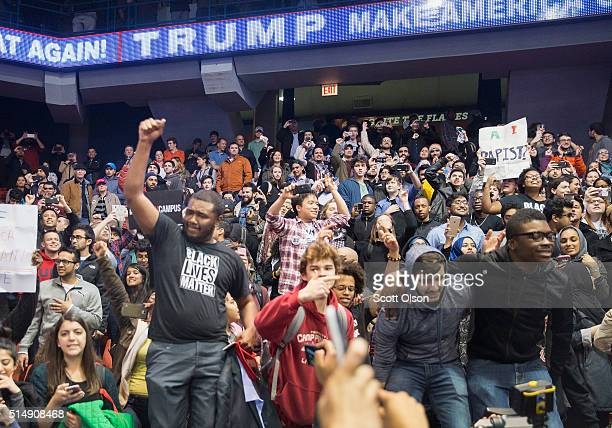 Demonstrators celebrate after it was announced that a rally with Republican presidential candidate Donald Trump at the University of Illinois at...