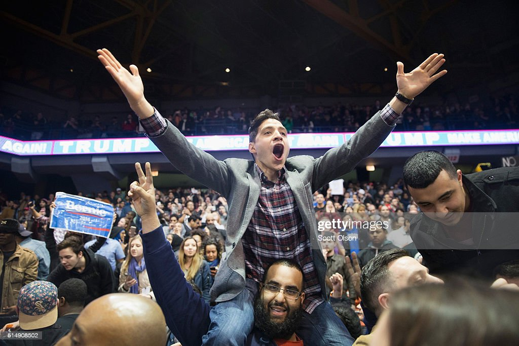 Demonstrators celebrate after it was announced that a rally with Republican presidential candidate Donald Trump at the University of Illinois at Chicago would be postponed on March 11, 2016 in Chicago, Illinois. Organizers postponed the rally citing safety reasons after hundreds of demonstrators were ticketed for the event.
