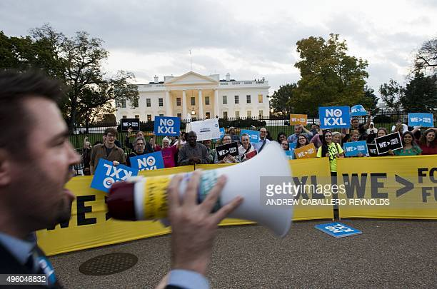 Demonstrators celebrating US President Barack Obama's blocking of the Keystone XL oil pipeline rally in front of the White House in Washington DC on...