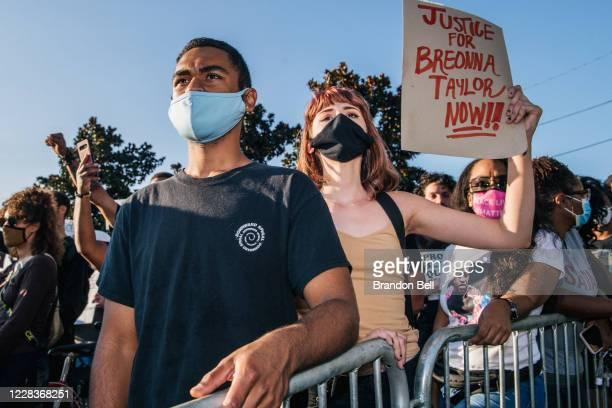 Demonstrators chant at law enforcement near Churchill Downs on September 5, 2020 in Louisville, Kentucky. Demonstrators marched to the Kentucky Derby...
