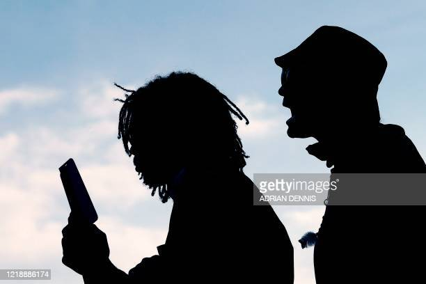 Demonstrators chant during a protest calling for the removal of a statue of British businessman and imperialist Cecil John Rhodes from outside Oriel...