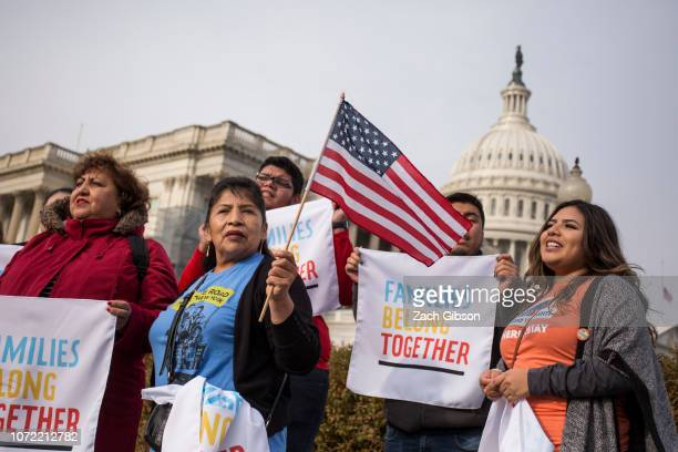 Demonstrators chant during a rally protesting against funding for the Trump administration's immigration policies organized by Families Belong...