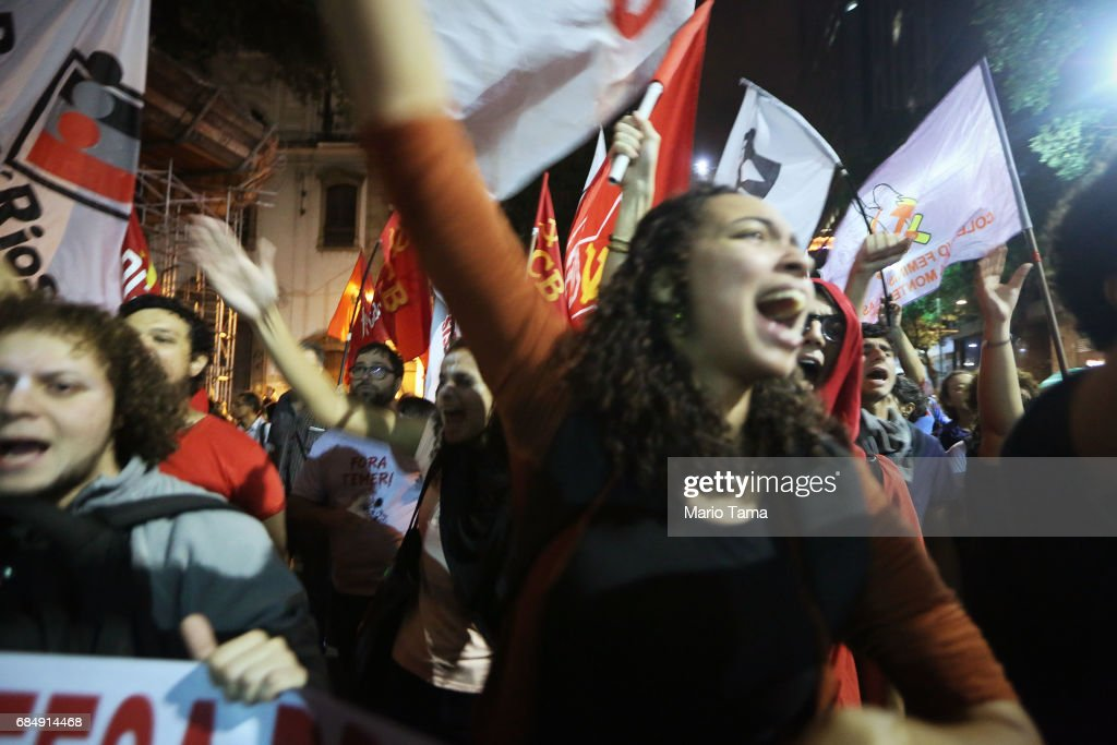 Demonstrators chant during an anti-Temer protest on May 18, 2017 in Rio de Janeiro, Brazil. Thousands of protestors hit the streets of Rio in the aftermath of a recording allegedly revealing President Michel Temer endorsing bribery payments.