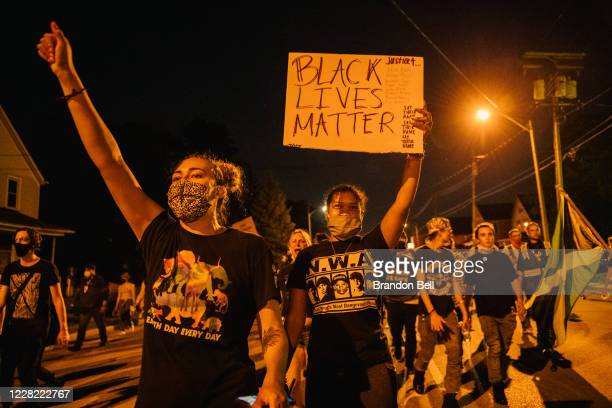 Demonstrators chant in a march on August 26 2020 in Kenosha Wisconsin As the city declared a state of emergency curfew a fourth night of civil unrest...