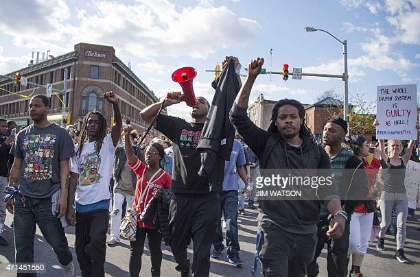 Demonstrators chant on Pennsylvania Avenue in Baltimore Maryland April 28 one day after violence and looting erupted following the funeral of...