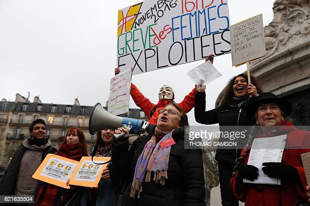 Demonstrators chant slogans as French protester JeanBaptiste Redde also known as Voltuan carries a sign during a demonstration for equal pay between...