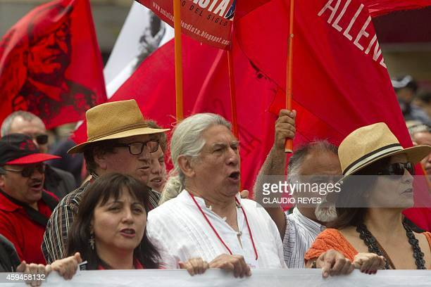 Demonstrators chant slogans during a protest demanding the creation of a constituent assembly to amend the 1980 constitution imposed by Chilean...