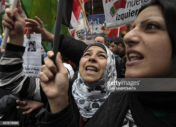 Demonstrators chant slogans during a protest demanding to Israel to stop the 'genocide' in the Gaza strip outside the Israeli embassy in Buenos Aires...