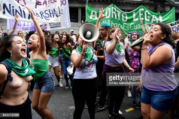 Demonstrators chant slogans during a rally in demand of women's access to safe free and legal abortion outside the National Congress in Buenos Aires...