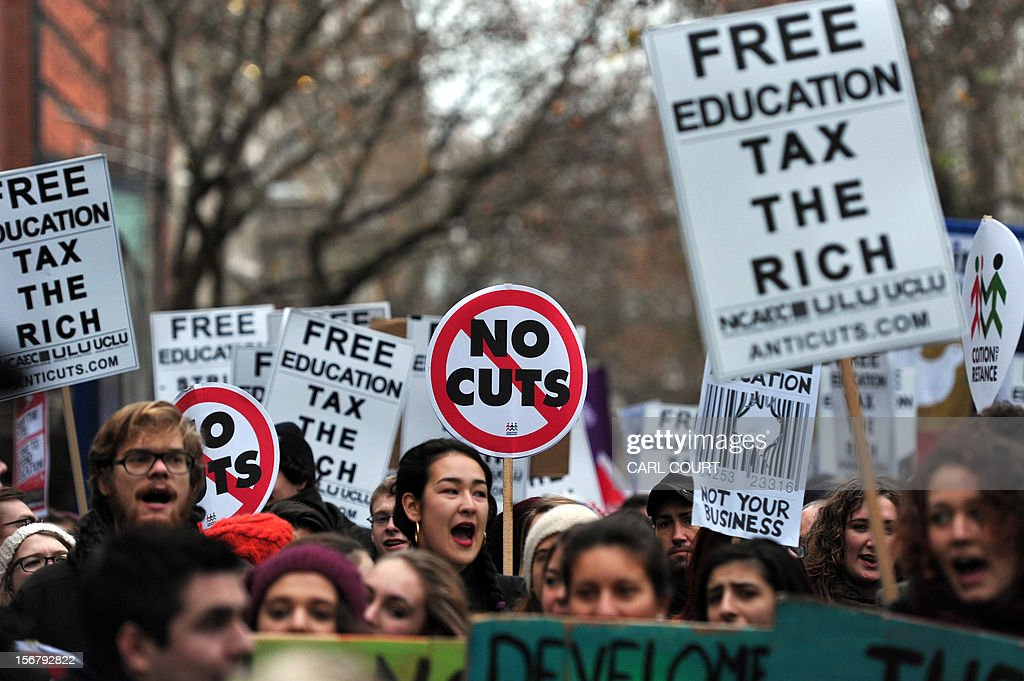 Demonstrators chant slogans during a student rally in central London on November 21, 2012 against sharp rises in university tuition fees, funding cuts and high youth unemployment.