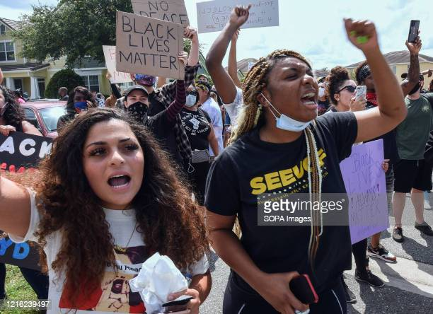Demonstrators chant slogans while marching outside a home owned by Derek Chauvin, the Minneapolis police officer filmed kneeling on the neck of...