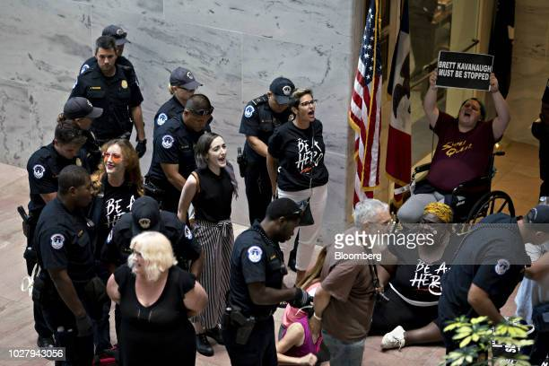 Demonstrators chant while being detained by US Capitol police outside the office of Senator Chuck Grassley a Republican from Iowa and chairman of the...