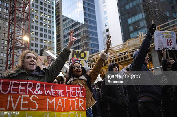 Demonstrators chant while carrying placards and banners during a protest outside the Republican Party's annual policy retreat in Philadelphia US on...