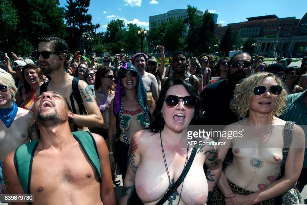 Demonstrators cheer as they begin to march during the 2017 GoTopless Day Parade on August 26 2017 in Denver Colorado Founded in 2007 by the French...