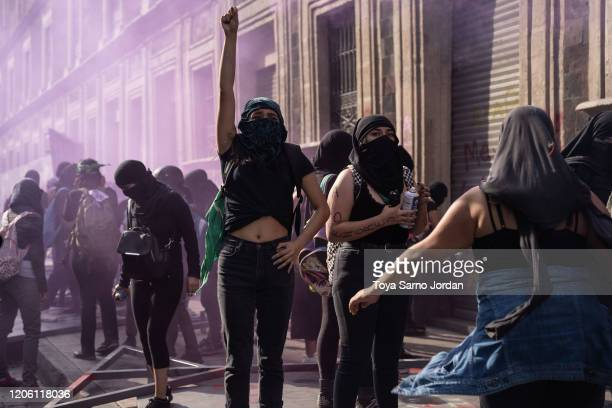 Demonstrators clah with police during a rally on International Women's Day on March 8 2020 in Mexico City Mexico