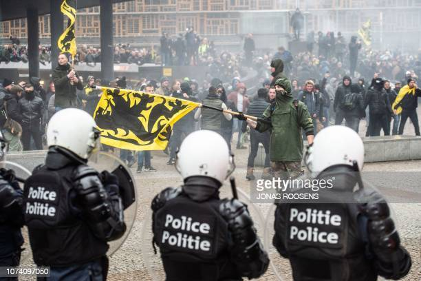 TOPSHOT Demonstrators clash with Belgian riot police during a march in Brussels on December 16 2018 called by the rightwing Flemish party Vlaams...