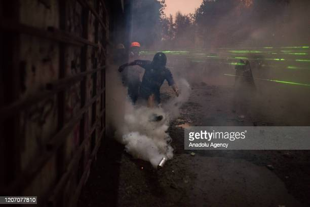 Demonstrators clash with Chilean riot police as riot police intervene them with tear gas and water cannons during a protest against President...