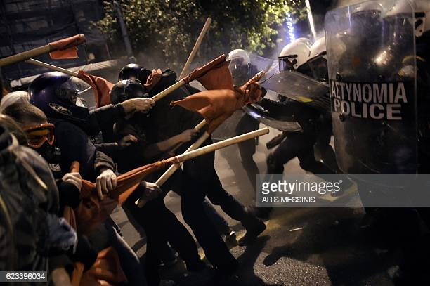 TOPSHOT Demonstrators clash with Greek riot police during a protest against the visit of the US president in Athens on November 15 2016 US President...