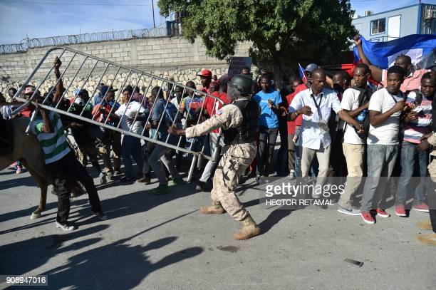 Demonstrators clash with Haitian National Police near the US Embassy in PortauPrince on January 22 during a protest against the disparaging comments...