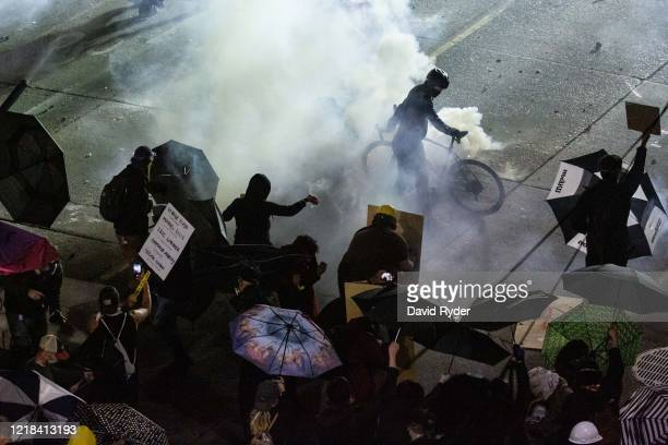 Demonstrators clash with law enforcement near the Seattle Police Departments East Precinct shortly after midnight on June 8, 2020 in Seattle,...