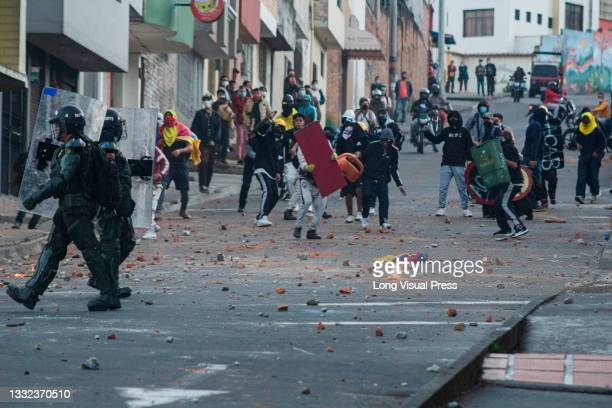 Demonstrators clash with molotov bombs against Colombia's riot police as demonstrations ended in late-night clashes between riot police and...