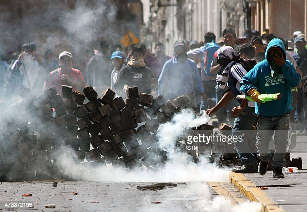 Demonstrators clash with Peruvian police forces in Arequipa on May 14 during a protest against a 1400 million dollars mining project by Southern Peru...