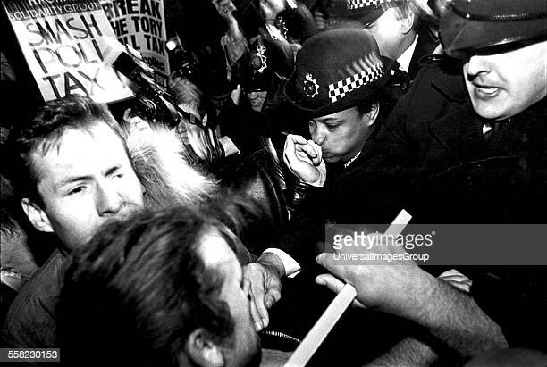 Demonstrators clash with police at Anti Poll Tax demo Hackney London 1980's