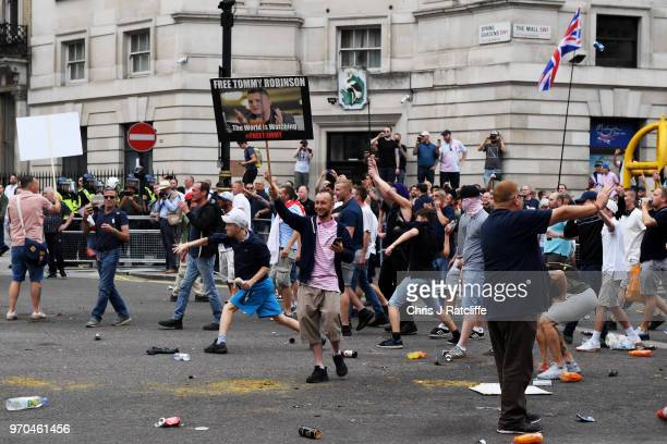 Demonstrators clash with police during a 'Free Tommy Robinson' protest on Whitehall on June 9 2018 in London England Protesters are calling for the...
