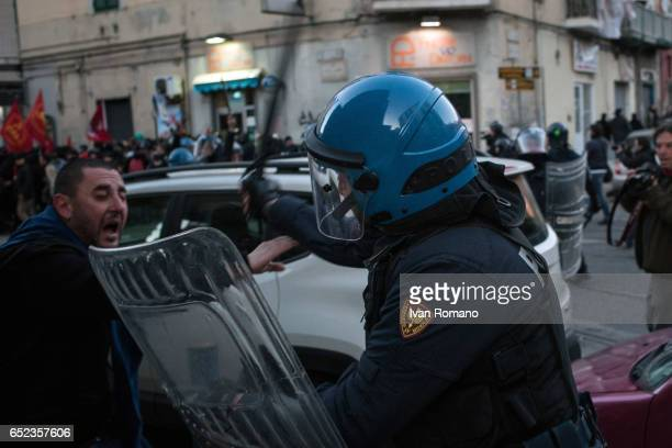 Demonstrators clash with police during a protest against Matteo Salvini leader of the Lega Nord during a political rally held at the Mostra...