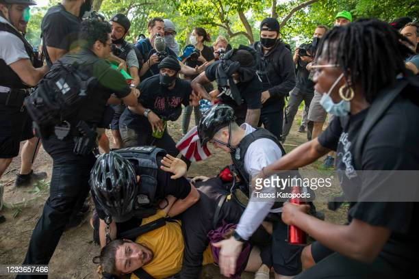 Demonstrators clash with police during a protest in response to the police killing of George Floyd in Lafayette Square Park on May 29 2020 in...