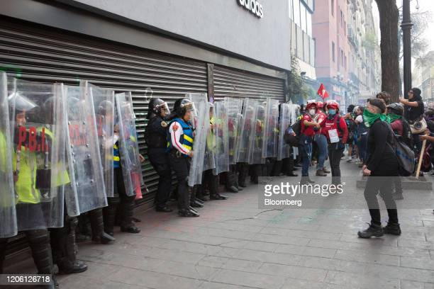 Demonstrators clash with police during a rally on International Women's Day in Mexico City Mexico on Friday March 8 2020 The United Nations first...