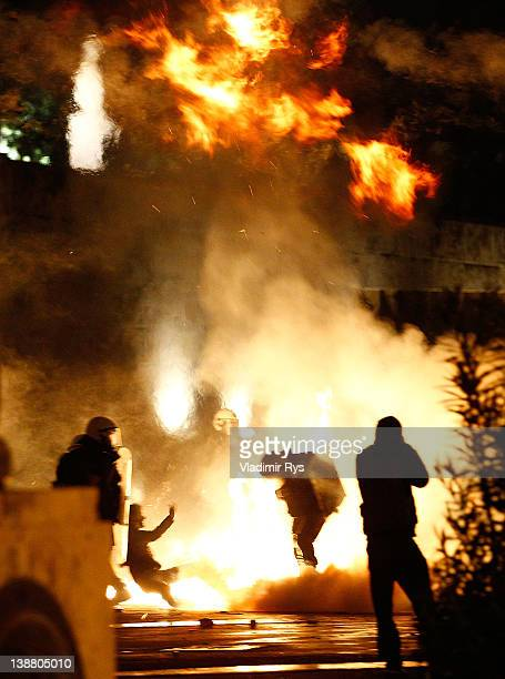 Demonstrators clash with police during the demonstration against the new austerity measures in Syntagma Square on February 12 2012 in Athens Greece...