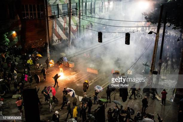 Demonstrators clash with police near the Seattle Police Departments East Precinct on June 7, 2020 in Seattle, Washington. Earlier in the evening, a...