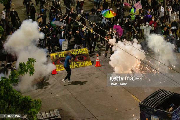 Demonstrators clash with police near the Seattle Police Departments East Precinct shortly after midnight on June 8, 2020 in Seattle, Washington....