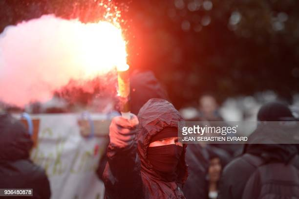 Demonstrators clash with police on March 22 2018 in Nantes as part of a nationwide day of protest against French president multifront reform drive...