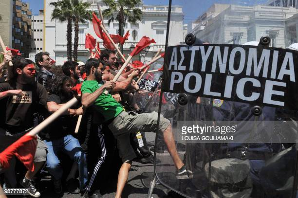 Demonstrators clash with policemen outside the greek Parliament during a Mayday demonstration on May 1 in Athens Greek police fired tear gas on...