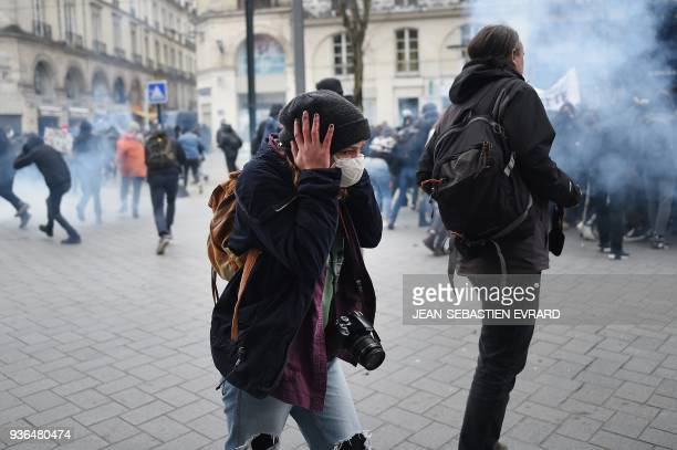 Demonstrators clash with riort police on March 22 2018 in Nantes as part of a nationwide day of protest against French president multifront reform...