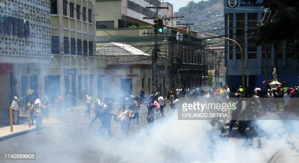 Demonstrators clash with riot police during a May Day protest in Tegucigalpa on May 1 2019