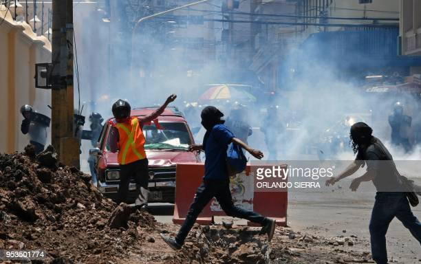 Demonstrators clash with riot police during a May Day protest demanding the resignation of President Juan Orlando Hernandez in Tegucigalpa on May 1st...